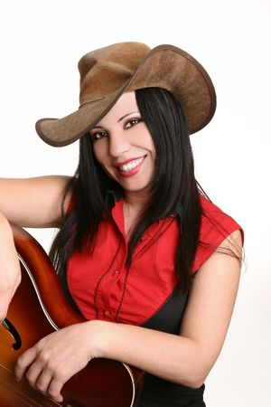 akubra: Casual smiling country girl in short sleeve black and red western shirt finished with metal collar tips. Stock Photo