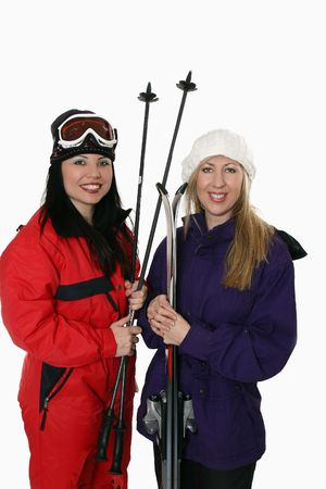 Two women ready to go skiing in winter. photo