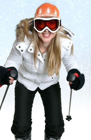 Female skier against a snowy backdrop