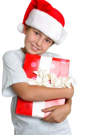 Love Gift Time.   Young child holding a Christmas present Stock Photo - 658144