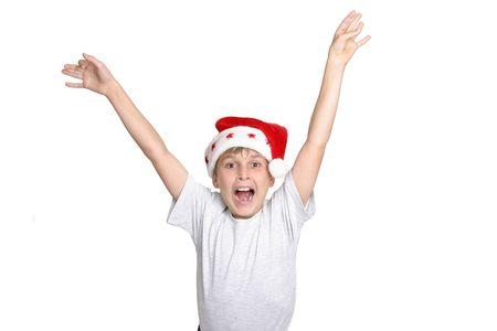 hooray: Hooray its Christmas.  A boy leaps for joy at Christmas time. Stock Photo