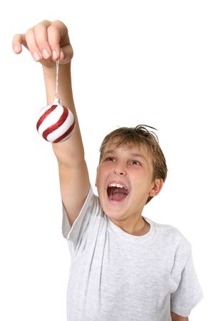 joyous: A joyous child hangs Christmas decorations