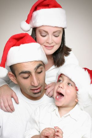 Multicultural family enjoyment at Christmas time. Stock Photo - 663723