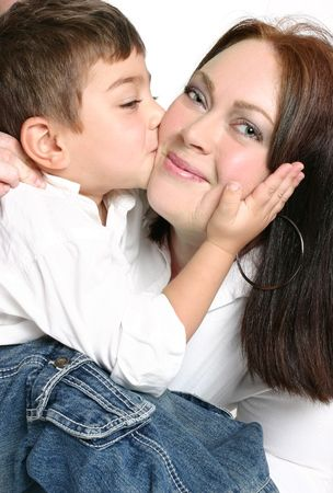 fond of children: A young toddler gives his mother a kiss on the cheek. Stock Photo