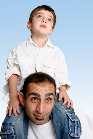 sky is the limit: Sky is the limit....   A child sits atop his fathers shoulders looking skyward.