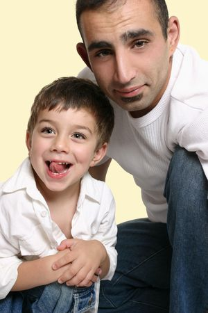 Casual portrait of a father with joyful son photo