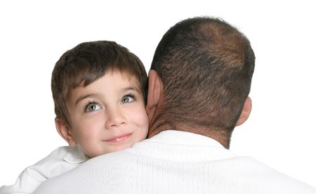 preoccupied: Daydreaming child in fathers arms, looking up and smiling, space for text. Stock Photo