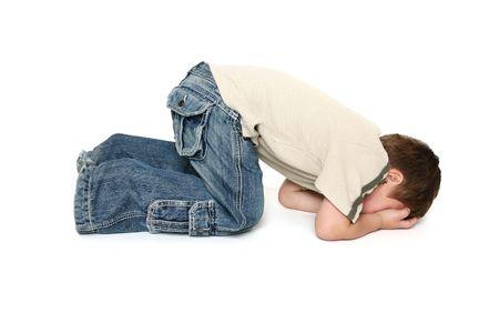 Child sulking or throwing a tantrum.