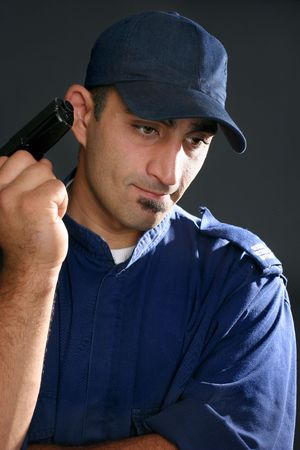 upholding: Security guard in blue uniform with gun.