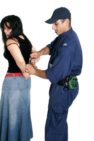apprehension: Suspect female being handcuffed by an officer