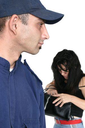 Security officer spots a thief rummaging through a stolen bag Stock Photo - 714920