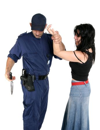 misdemeanor: Officer apprehends and disarms a knife from a rough female criminal Stock Photo