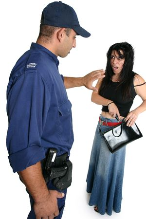 Security officer approaches an armed criminal with caution. Stock Photo - 714922