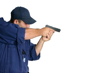 Officer using a weapon during duty or weapons handling training, white background, space for text Stock Photo - 714494