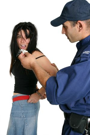 restraints: Drugs Possession.  An apprehended female found with drugs possession Stock Photo