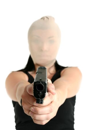 heist: Armed and dangerous criminal brandishing a gun Stock Photo