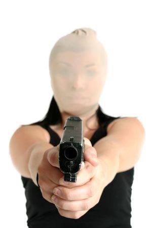 Armed and dangerous criminal brandishing a gun Stock Photo - 714502