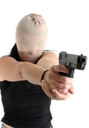 An armed robber menaces and threatens with a gun during a robbery. Stock Photo - 714504