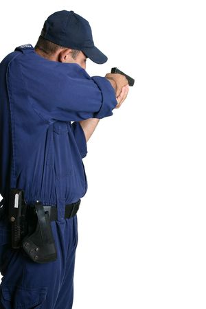 A security officer stands and aims his weapon while on duty or weapons training. Stock Photo - 714912
