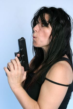 perpetrator: Rough looking female underworld character with a gun