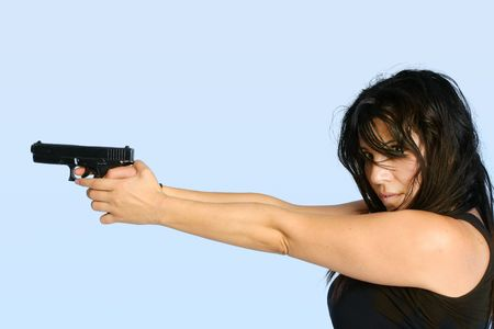 Gangster Girl.  Female gangster criminal  holding a gun ready to shoot Stock Photo - 722794