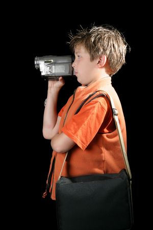 A child using a digital video camera to record a home movie. photo