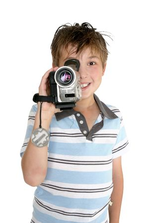 A child taking some video footage with a digital video camera. photo