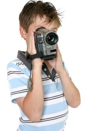 handheld: Boy using a handheld digital video camera Stock Photo