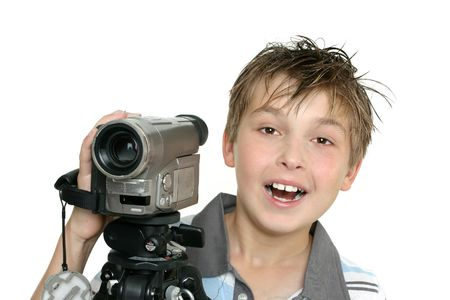 A happy child using a video camera and tripod photo
