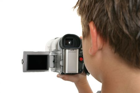 Watching a video playback on the camera lcd screen.  Focus on video camera.    Screen left blank to add your movie, picture or message if desired.