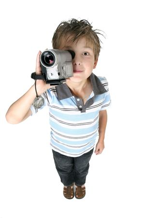 camcorder: A boy recording videos or taking pictures using a digital video camera,  above perspective. Stock Photo