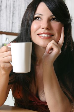 Woman sitting down with a cup of hot coffee Stock Photo - 753718