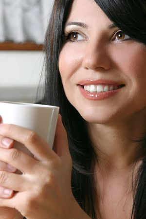 A woman leisurely relaxes with a hot beverage. Stock Photo - 753716