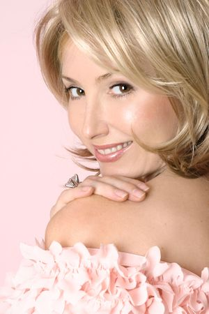 Friendly, smiling adult woman looking over shoulder photo
