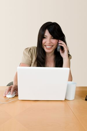 courteous: A woman at work using the telephone.