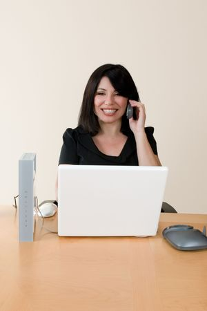 courteous: Emerging technologies - a woman using voip technology to make an internet phone call.