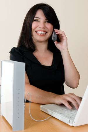 courteous: a woman enjoys the freedom of wireless networking and phone calls Stock Photo