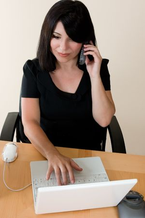 Woman working and using the phone Stock Photo - 776829