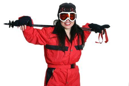 Woman in ski clothing resting arms on ski poles. photo