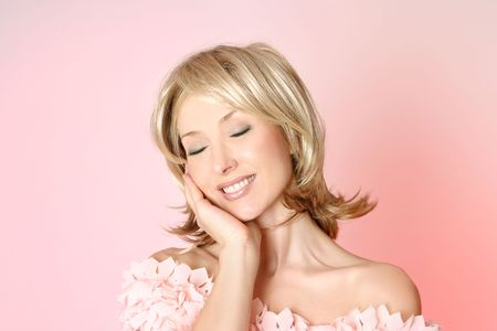 gently: Femininity.  Smiling woman resting head gently to one side Stock Photo