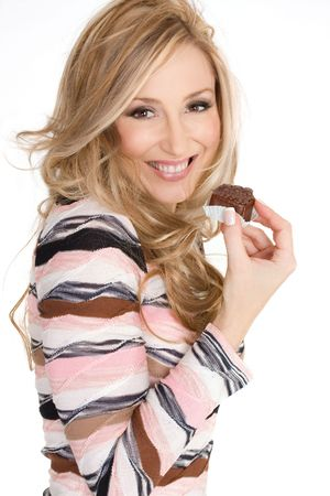 Fun-loving smiling female holding a delicious milk chocolate truffle photo