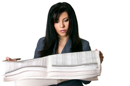 A businesswoman get the latest finance news on oil and mining markets. photo
