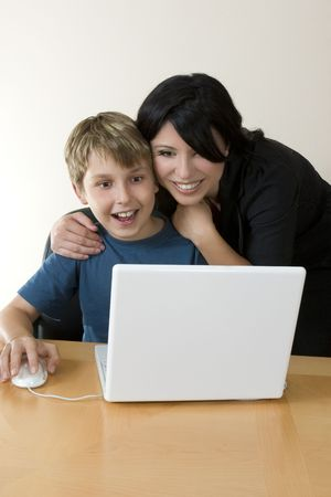 computer instruction: Adult and child explore the internet or computer software, games, etc.