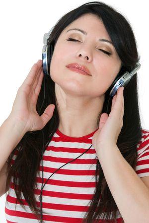 aural: A woman listens to music through headphones