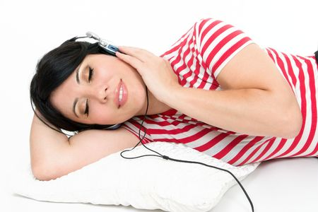 A woman at leisure relaxes to some music