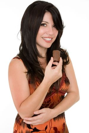 Woman in summer dress enjoying a chocolate snack in moderation. Stock Photo - 840762