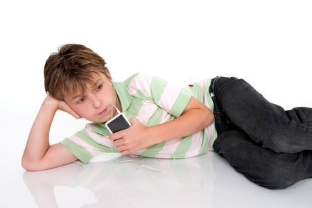 A child relaxes with a portable digital mp3 player photo