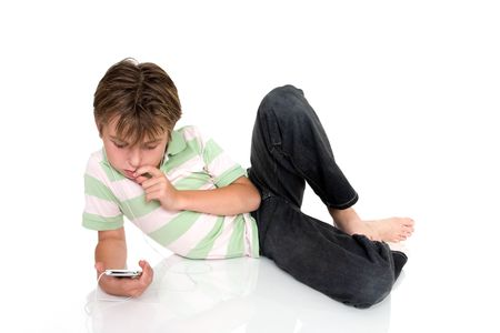 Child relaxing with electronic music player. photo