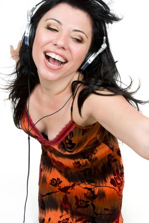 A spirited girl dances to music Stock Photo - 894456