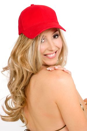 blond brown: Bikini woman wilth blonde curled hair looking over her shoulder and smiling.